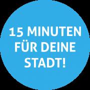 """(""""15 Minuten für deiner Stadt"""" in einem blauen Kreis)"""